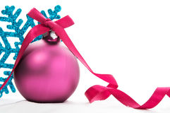 Purple xmas ball and blue snowflake Stock Images