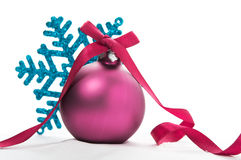 Purple xmas ball and blue snowflake on the white Royalty Free Stock Photography