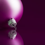 Purple xmas ball on dark background Stock Images