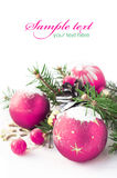 Purple xmas baubles on the white Stock Photography