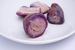 Purple yam for desserts. Thai purple yam on white plate royalty free stock photo