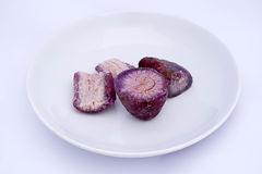 Purple yam for desserts. Thai purple yam on white plate royalty free stock photos