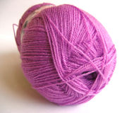 Purple yarn. A ball of acrylic yarn Royalty Free Stock Photography