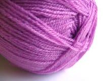 Purple yarn. A ball of acrylic yarn Royalty Free Stock Photos
