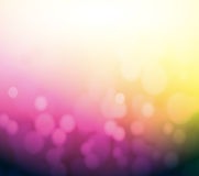 Purple and yellow bokeh abstract light background. Royalty Free Stock Image