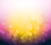 Purple and yellow bokeh abstract light background. Royalty Free Stock Photography