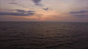 Purple and yellow color evening sky over the sea with gentle waves, Gulf of Thailand. Sunset sky stock video footage