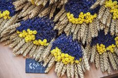 Flowers in the market of Provence, France. Purple, yellow flowers, bouquets, lavender and wheat in the market of Provence, France Royalty Free Stock Image
