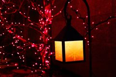 Purple and yellow holiday decorations. Christmas decorations in the form of purple and yellow lights and lantern showing snowflakes in silhouette Stock Images