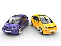 Purple and yellow small economic cars - top view Royalty Free Stock Photography