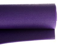 Purple yoga mat on white Stock Photo