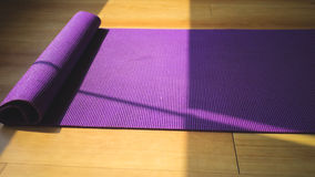 Purple yoga matt. Stock Photo