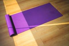 Purple yoga matt. Royalty Free Stock Images