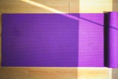 Purple yoga matt. Stock Photos