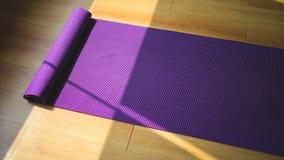 Purple yoga matt. Stock Images