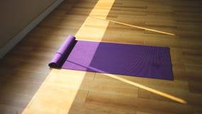 Purple yoga matt. Stock Photography
