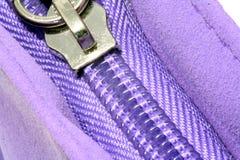 Purple zipper. A closed zipper on purple suede material Stock Photography