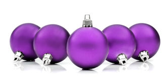 Purplw christmas baubles Royalty Free Stock Image