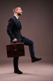 Purposeful businessman comes up with a briefcase Royalty Free Stock Image
