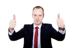 Purposeful businessman. hands clenched into fists and thumbs up. Royalty Free Stock Photography
