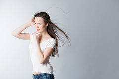 Purposeful woman with hair in the wind Royalty Free Stock Images
