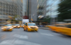Purposely Blurred taxi cabs in NYC Royalty Free Stock Photography