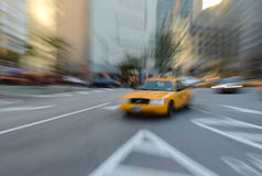 Purposely Blurred taxi cabs in NYC Stock Photography