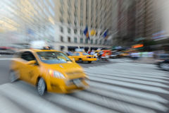 Purposely Blurred taxi cabs in NYC Royalty Free Stock Photos