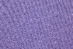 Purpurfärgad backround för abstrakt begrepp för linnekanfas - lagerföra fotoet Arkivbilder