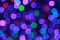 Purpurfärgad bakgrundsbokehsuddighet Arkivbilder