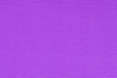 Purpurfärgad dekorativ bakgrund för polyestertygtextur, slut upp Royaltyfri Fotografi