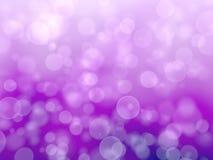Purpurfärgad festlig abstrakt bakgrund med bokeh Arkivfoto