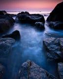 Purpurfärgad Guernsey solnedgång royaltyfria foton