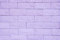 Purpurfärgad textur för tegelstenvägg arkivfoton