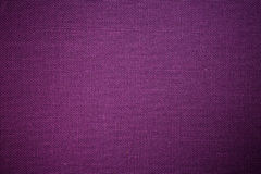 Purpurfärgad tygbakgrund Arkivfoto