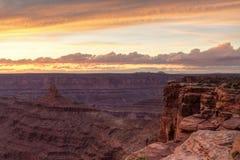 Purpurfärgade kanjoner på solnedgången Fotografering för Bildbyråer