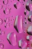 Purpurfärgade små droppar Fotografering för Bildbyråer