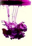 Purpurfärgat färgpulver Arkivbild