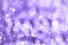 Purpurowa obfitość latająca wakacyjna światła bokeh tekstura - ładny abstrakcjonistyczny fotografii tło obrazy stock