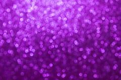 Purpurowego bokeh abstrakcjonistyczny tło, Świąteczny tło obrazy royalty free