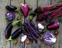 Purpurowi warzywa na drewnianym tle Obraz Royalty Free