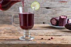 Purpurowy kukurydzanego soku drewna stołu tło Zdjęcie Stock