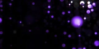 Purpurowy violett splendoru światła bokeh cząsteczek ruch spada w czarnej nocy zbiory