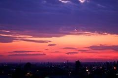 Purpurowy zmierzch nad Bucharest miastem Obraz Royalty Free