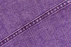 Purpurowych cajgów sukienna tekstura z ściegiem Obrazy Stock