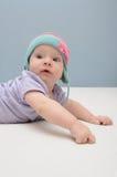 Purpurrote Babys fangen zuerst Stockbild