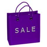 Purpurrote Einkaufstasche mit Wortverkauf Lizenzfreies Stockfoto