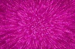 Purpurrote Funkelnexplosion beleuchtet abstrakten Hintergrund Stockfoto