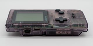 Purpurrote Game Boy-Tasche, tragbares Spiel der Weinlese durch Nintendo illus stockfotografie