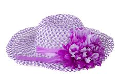 Purpurroter Hut der Frauen mit einer Blume. Lizenzfreies Stockfoto